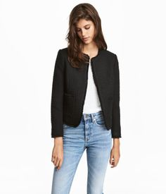 Black. Short jacket in woven textured fabric with raw, frayed edges and front pockets. No fastenings. Lined.