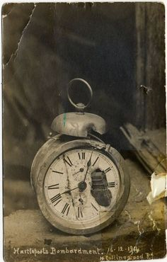 An alarm clock with a piece of German shell embedded in the dial, from the German naval raid on Hartlepool, 16 December 1914
