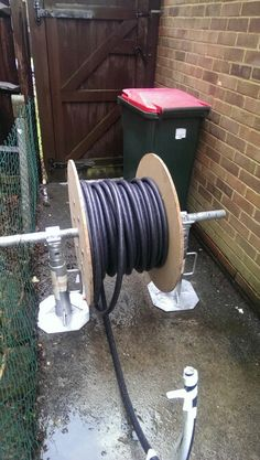 Ran 50+ metres of heavy duty armoured cable to a garden room today. It was so heavy it took 2 of us to lift the reel on to the jacks so that it could be unwound easily.
