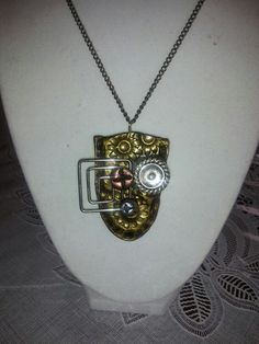 Polymer clay pendant with metal embelishments by Bhavna Mistry