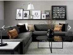 Grey walls with a dark couch. Looks elegant, classy.