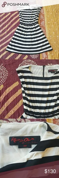 NWT Alice + Olivia B & W Striped Mini Dress XS Graphic black & white stripes Sleeveless, elastic waist Soft jersey cotton, with underlining  Exposed black zipper at back  Mini length flared skirt Made by Alice + Olivia, size XS  Retailed for $242, tags still attached  In good condition Alice + Olivia Dresses Mini
