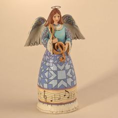 Music Angel holding Treble Cle