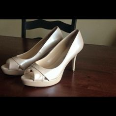 Nude peep toe heels Best shade of nude has some shine to it. Peep toe. Preowned. in great condition Audrey Brooke Shoes Heels