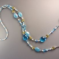 Handmade lariat using Agate gemstones | Shell | Crystals | Glass beads.   Lively and cheerful design. Total length is about 32 inches, adjustable length to suit the wearer.   One-of-a-kind. You will receive this item you see right here.  ** Kindly note that all packages are sent out from SI...
