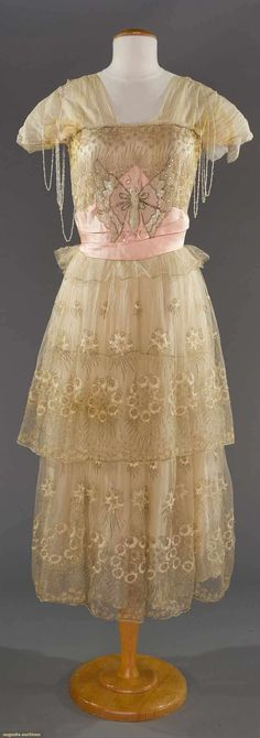 BEADED PARTY GOWN, c. 1915 White net w/ gold & ivory embroidery, beaded butterfly on bodice,