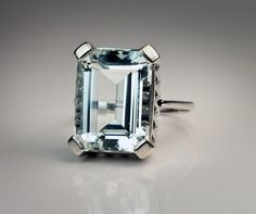 A Vintage Art Deco Aquamarine RingEuropean, circa 1935A white 585 gold (14K) ring features an emerald-cut aquamarine of a silvery cool blue color.Aquamarine - 16.05 x 11.9 x 7.4 mm, approximately 9.68 ct.US ring size 8 1/2 (18.5 mm)This ring can be easily sized.$2,600.00. The perfect engagement ring