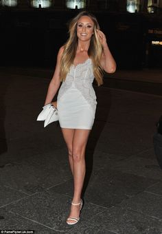Looking all-white: Charlotte Crosby ignored the bitter cold weather as she enjoyed a night out in Newcastle on Monday, wearing a tiny white dress and flaunting her fabulous trim figure | Ace it in lace for your next night out in Charlotte's Dolls House Cami Baroque Dress in ivory, reduced to £165