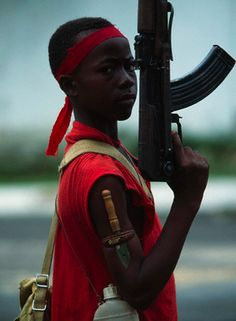 A young soldier with the NPFL (National Patriotic Front of Liberia) rebels in Monrovia, Liberia. April 22, 1996. © Patrick Robert/Sygma/Corbis