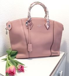 Louis Vuitton Lockit PM in the color Magnolia, a beautiful pink. Dressed up with two Hermes twilly's to protect  the handles.