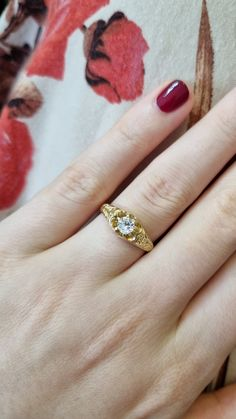 The shoulders of this Victorian style engagement ring have been hand engraved with leaves and scrolls. An old-cut cushion-shaped diamond that weighs 0.28ct is nestled in a six-claw setting that resembles the shape of a flower.We have a gorgeous selection of rings inspired by the Victorian era. Or why not book yourself an appointment to view the rings in person? We are open Monday – Friday. #AntiqueStyleRing #DiamondRing #DiamondEngagementRing #YellowGoldRing Victorian Engagement Rings, Designer Engagement Rings, Diamond Engagement Rings, Victorian Jewelry, Victorian Era, Victorian Fashion, Monday Friday, Conflict Free Diamonds