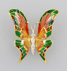 "Brooch ""butterfly"" with enamel and diamonds, YG/WG 750/000, body in WG with 6 8/8-diamonds total approx. 0.12 ct Cape/si, Flügel partly needle etching and colorful translucid enameled (partly flawed), so-called Fenster- email, also usuable as pendant, total approx. 15.5 g  Estimation 320€"