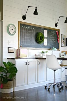 office space with large desk and chalkboard