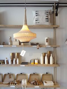 wooden shelves with vertical rope supports / hanging shelves