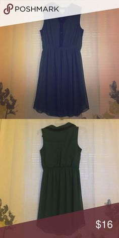 Green sleeveless flowy soft dress w/ black trim Button down front with shelf-less camisole attached, black trim on front and color, tie at waist in front, soft flowy material, dark green color. Very comfortable for summer. Ask me about negotiating the cost and shipping! sweet storm Dresses