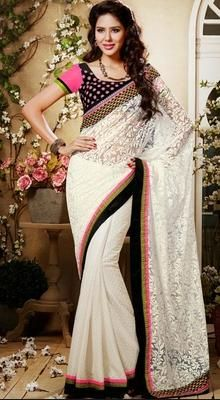 Spread the aura of freshness with this ethnic off white brasso georgette and net half n half saree. First half of the saree made of brasso print georgette and second half is made of matching same colored net gives a touch of sensuality. Saree features contrast velvet resham and crystals embroidered border all around which personifies the entire appearance. #DesignerSaree