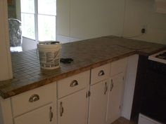 Tiling laminate counter tops  DIY I think I am SO doing this to spruce up the counters in the kitchen and one bathroom