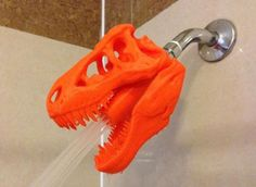 Transport your bathroom back to the dinosaur age with a shower head modeled after a toothy Tyrannosaurus rex skull.