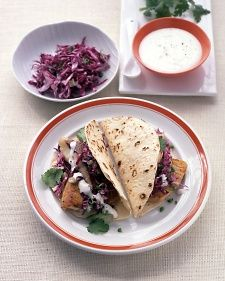 Tilapia tacos with red cabbage slaw and cilantro cream sauce. I personally prefer to blacken the tilapia for a little extra spice! Use corn tortillas for a gluten-free meal.