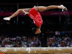 Gabby Douglas performs on the balance beam in the Artistic Gymnastics Women's Team final at the London 2012 Olympic Games on July 31, 2012 || Getty Images