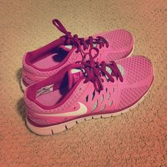 Nike tennis shoes Pink and turquoise Nike fitsoles tennis shoes. Super comfy and in very good condition! Nike Shoes Athletic Shoes