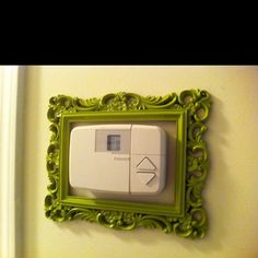 Decorative frame for the thermostat :) got a cheap frame from TJ Max, then spray painted it.