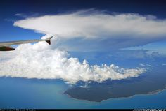 In flight from Darwin to Singapore. A huge thunderstorm overhead Bathurst Island. - Photo taken at In Flight in Northern Territory, Australia on March Jetstar Airways, Aircraft Pictures, Airplane View, Singapore, Aviation, Australia, Clouds, Outdoor