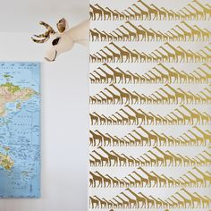 Gold Giraffe Wallpaper - modern and graphic wallpaper that we just love for a nursery accent wall!