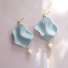 For a truly elegant statement earring, the Low Tides featuring freshwater pearls are a perfect choice. polymer clay and freshwater baroque pearls nickel-free gold plated posts gold-plated jump rings long grams each (less than a nickel) Polymer Clay Charms, Polymer Clay Art, Handmade Polymer Clay, Polymer Clay Jewelry, Resin Jewelry, Jewelry Crafts, Clay Beads, Gold Jewelry, Jewelry Accessories