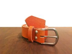 """All belts are custom made to size from 8-9 oz leather. To determine the desired belt size, measure your belt from the fold to the """" hold"""" most used, This measurement would be the center hold and belt size you would need to select for orders. Do not measure the total length! See sizing chart in photo displays. If we send you a belt based on your specific request and it is not to your suite we are unable to accept returns.    Each belt has been cut, punched, stitched and finished by hand. The…"""