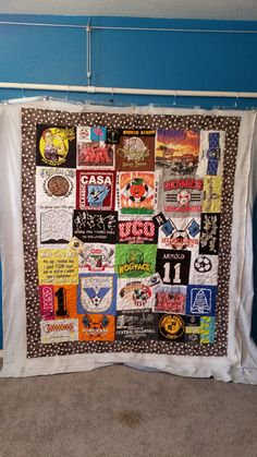 T-shirt quilt made by Pam G.  Longarmed by Le Ann Weaver of Persimmon quilts.