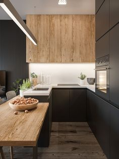 This kitchen sports flooring, cabinets, and a countertop/workspace with nearly matching surfaces for a unified look that accentuates the other, more dramatic design elements.