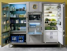 Meneghini refrigerators and freezers are best described as Italian Antique Modern in aesthetics, with brass handles and hinges, glass shelving, and various other pleasing details like portholes and clawfoot legs to distinguish themselves from their utilitarian counterparts.