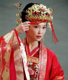 The colour red is a very important colour in the traditional attire of Chinese brides. Considered a colour of luck, red is worn not only on the dress, but is also displayed in many aspects of the traditional wedding day decor.