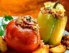 Tomatoes and peppers stuffed with rice. This is the simplest and most extraordinary summer food. A common variation includes minced meat as well. Greek Recipes, My Recipes, Teriyaki Burgers, Pan Seared Salmon, Greek Dishes, Beef Ribs, Vegetarian Options, Seafood Restaurant, Roasted Chicken
