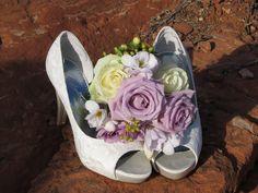 Brides shoes with flower arrangement on the red rocks of Sedona, Arizona. www.sedonadestinationweddings.com