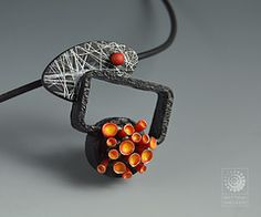 Bettina Welker's Shadowbox Pendant/Pin. Made from polymer clay.