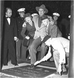 John Wayne leaving his footprints at Grauman's Chinese Theater - Hollywood - Jan 25th, 1950