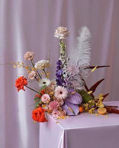 Lavender and flame floral arrangement