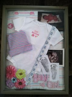 Shadowbox I made with Leah's baby items...coming home outfits, hat, ultrasound pic and footprints and when she was first born pic. Measuring tape with heart at her length. Love it!!!!