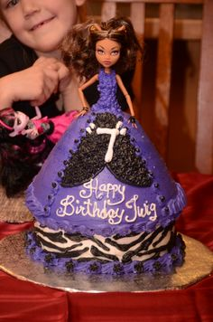 Monster High dress cake without using rolled fondant which I think is pretty, but tastes disgusting.  Clawdeen Wolf.