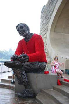 Yarn bombing a Mr. Rogers Sweater for a Mr. Rogers statue.
