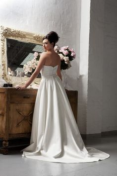7968 - Strapless satin tulip-shaped sheath with gown with detachable overskirt (7968S). Thin crystal belt included.
