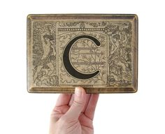 monogram C plaque from 1922 french dictionary