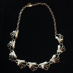 """Vintage ❄️Frosted Feathers❄️ Necklace Frosted feather like shapes, with each end of chain link extension for choice of length around the neck. Signed """"Sarah Coventry"""" and SC initials. Very Good Condition looks New. Adjustable clip - mixed Metal gold and silver tone necklace. Sarah Coventry Jewelry Necklaces"""