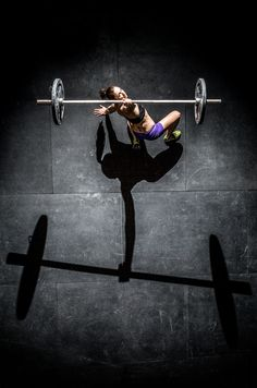 Female crossfit athlete lifts a barbell with one arm.  Beautiful Strength  Photograph by Tai Randall