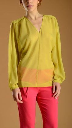 Buttoned puff long sleeve, V neck oversize lime blouse featuring a fabric detail on gathered shoulder, curved asymmetric hem.