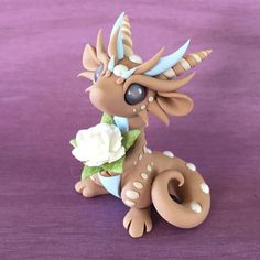 Summer-Rose-Dragon-Sculpture-by-Dragons-and-Beasties