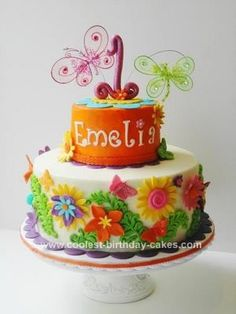 Homemade 1st Birthday Cake: This 1st birthday cake was done for a one year old who loves flowers and butterflies. I had done this little girl's baby shower cake before she was born,