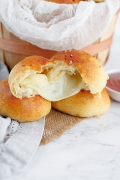 Cheese Stuffed Biscuits - Kick dinner biscuits up a notch by stuffing them with melty cheese before baking them to ooey-gooey perfection. Stuffed Biscuits, Cheese Biscuits, Baked Cheese, How To Make Cheese, Cheese Ball, Finger Foods, Hamburger, Stuffing, Snacks